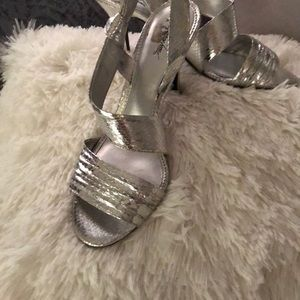 Silver heels with wide crossover straps